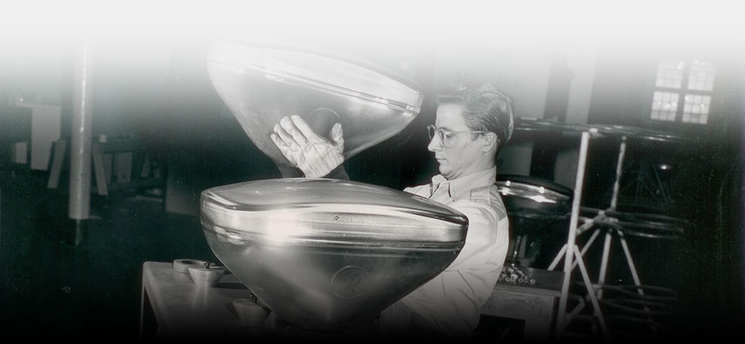Historic photo of an employee working with a cathode ray tube.
